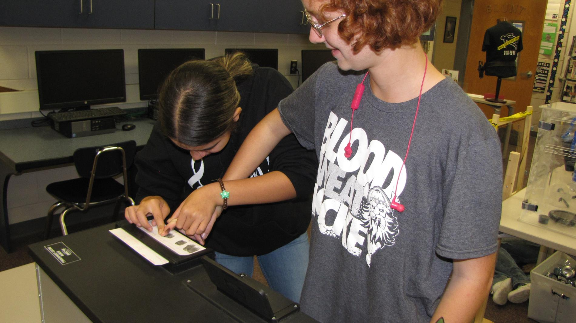 Students identifying and rolling fingerprints