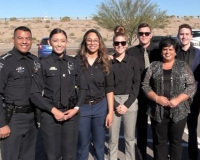 Law and Public Safety students stand with teacher and officer