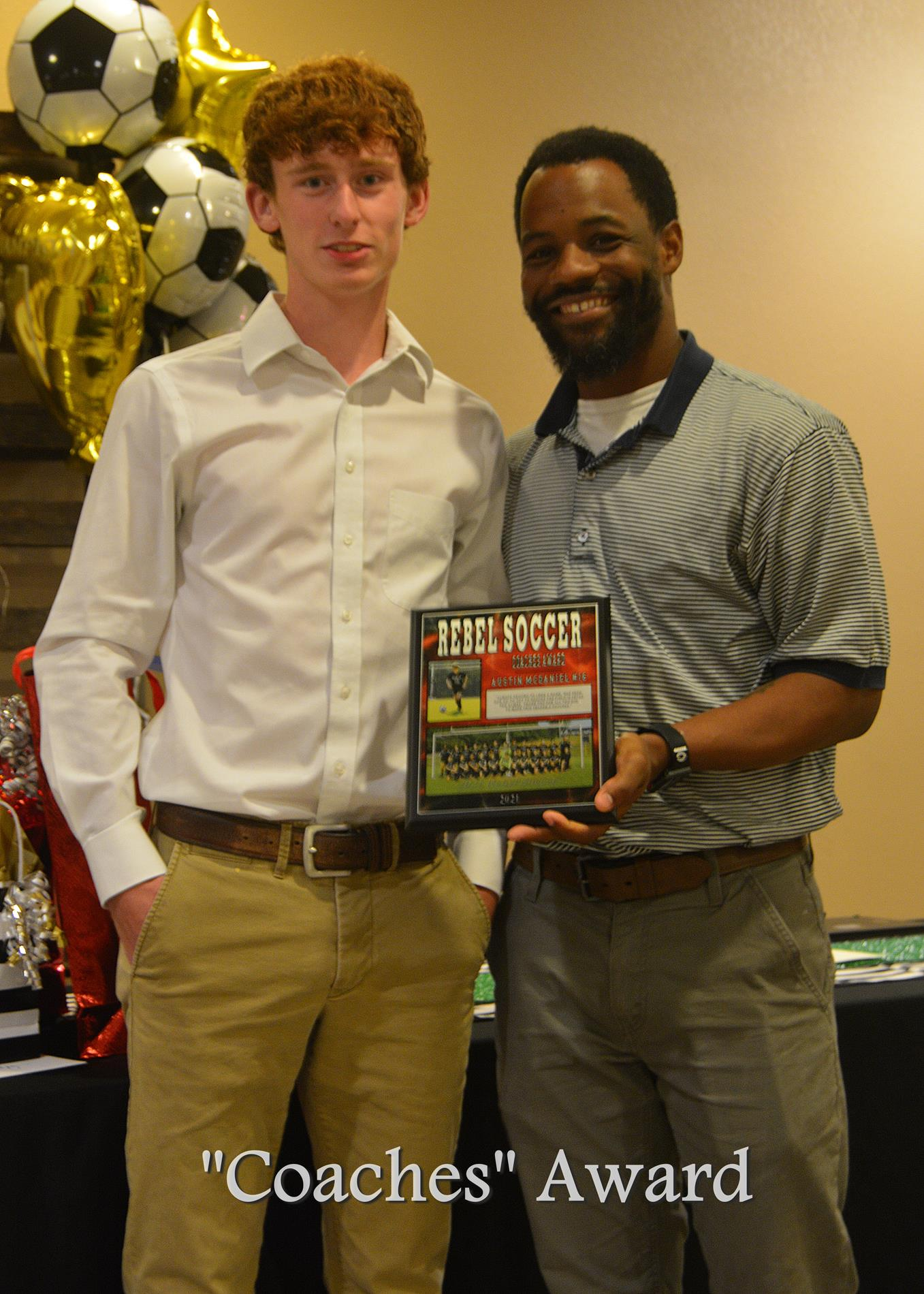 Austin McDaniel receiving the Coaches Award