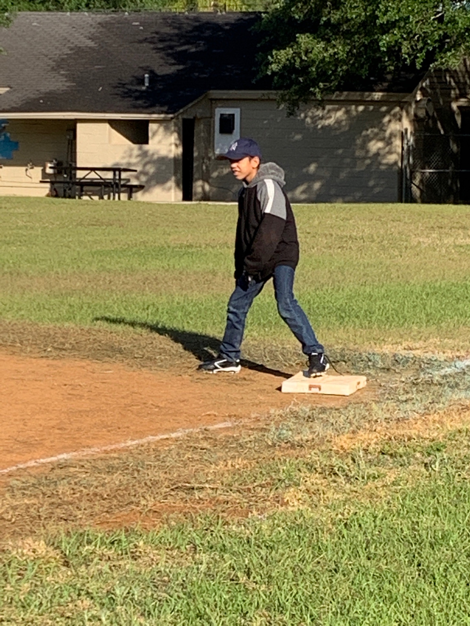 A 5th grade student on 1st base.