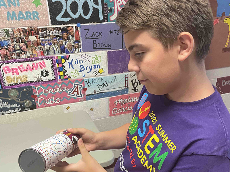 boy with experiment during STEM Academy