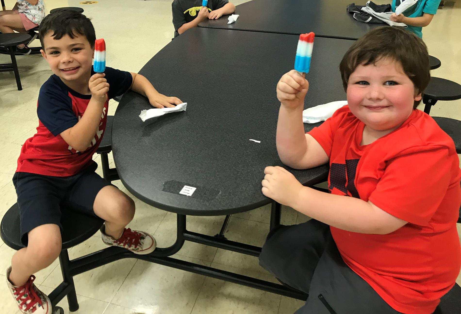 students eating popsicles