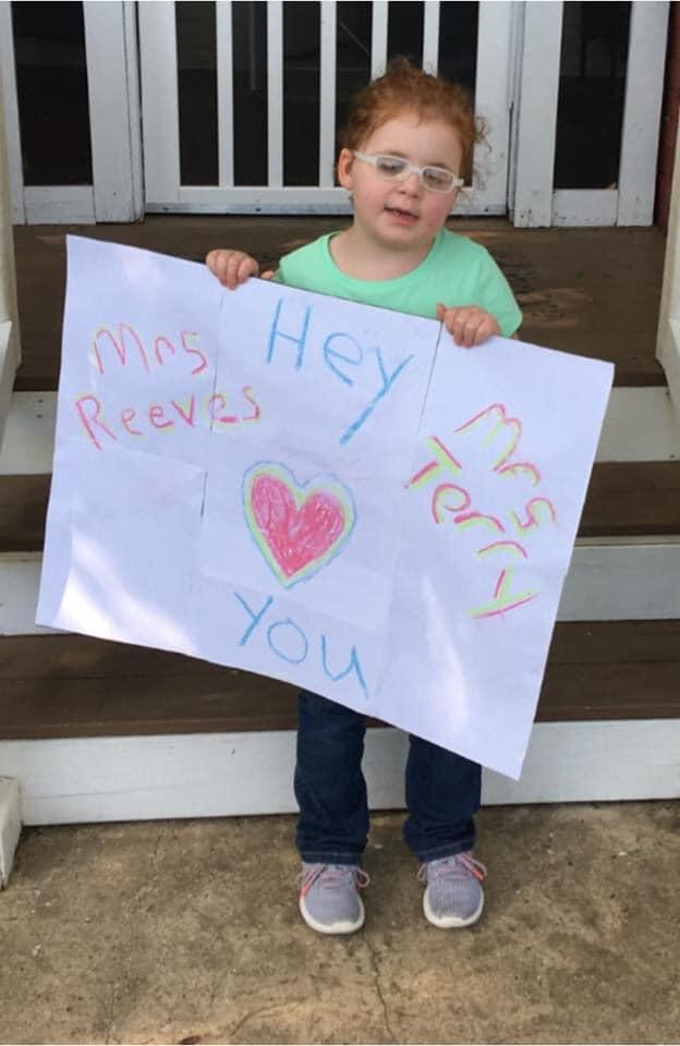 child holding sign