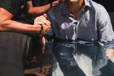 man being baptisized