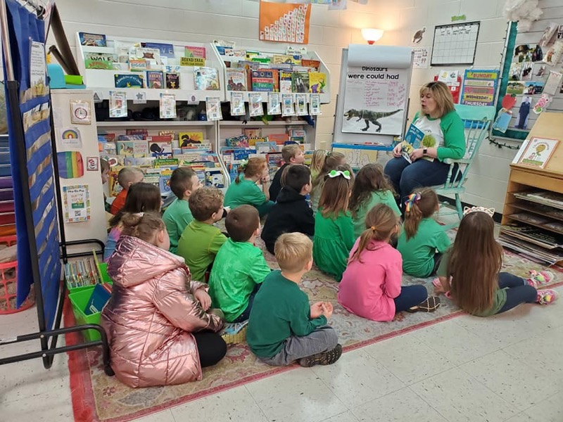 Mrs. Cook reading to class