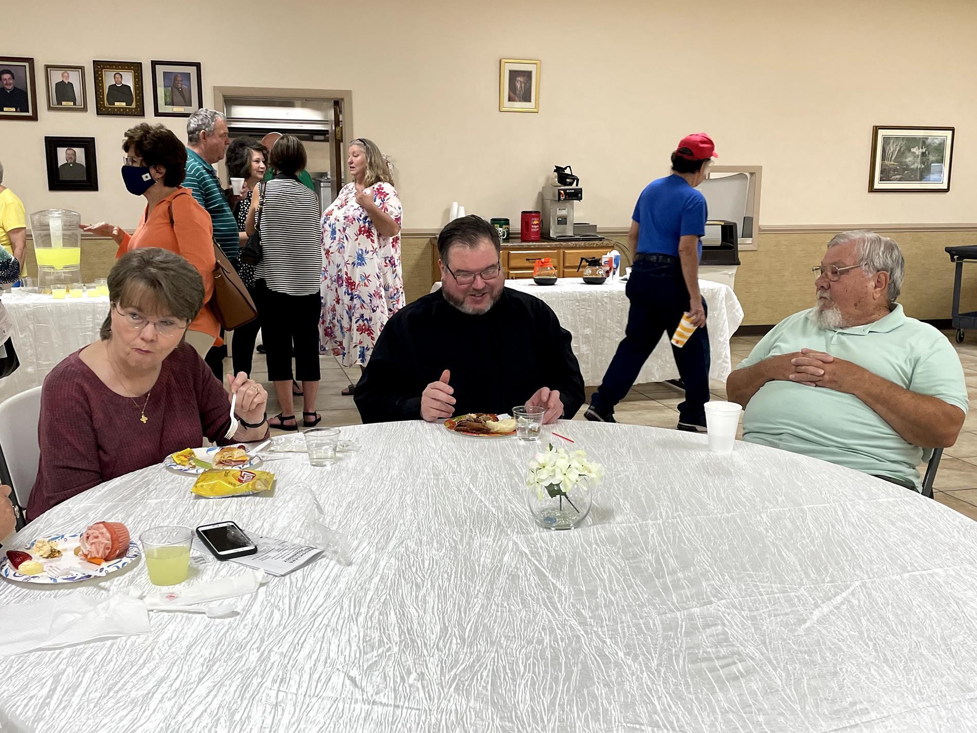 Visiting with parishioners