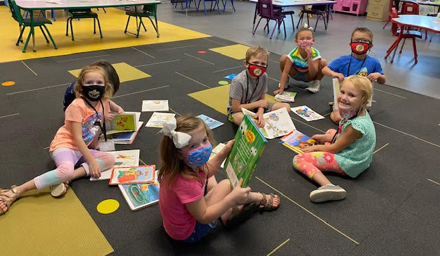 These kiddos love to check out new books from the library!