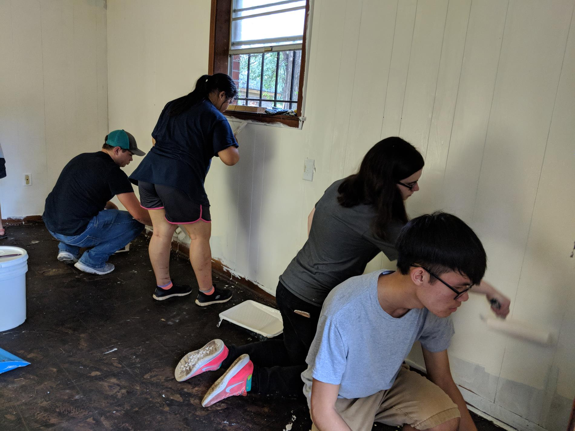 Jason Saucier, Rosemary Meas, Ashleigh Nelson, and Aaron B hard at work painting.