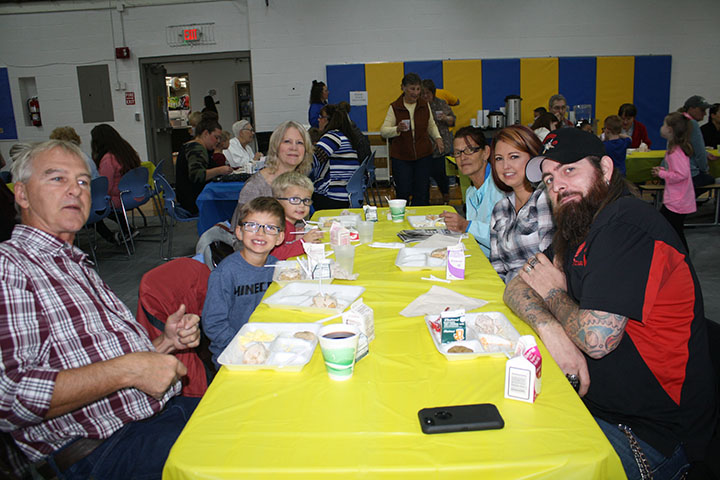 Elementary Students enjoying Breakfast with family