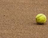 Yellow Softball Laying on Field