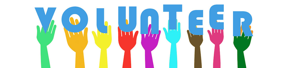 volunteer with different colored hands behind every letter