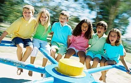children on a merry go round