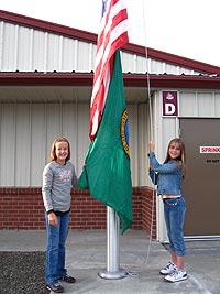 Students raising the flag