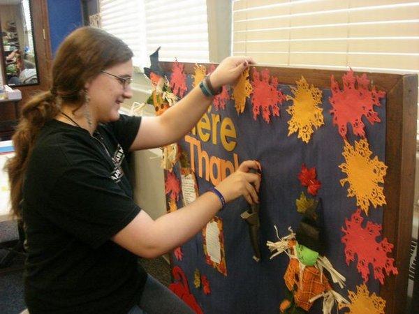 Hannah works on a Thanksgiving B Board.