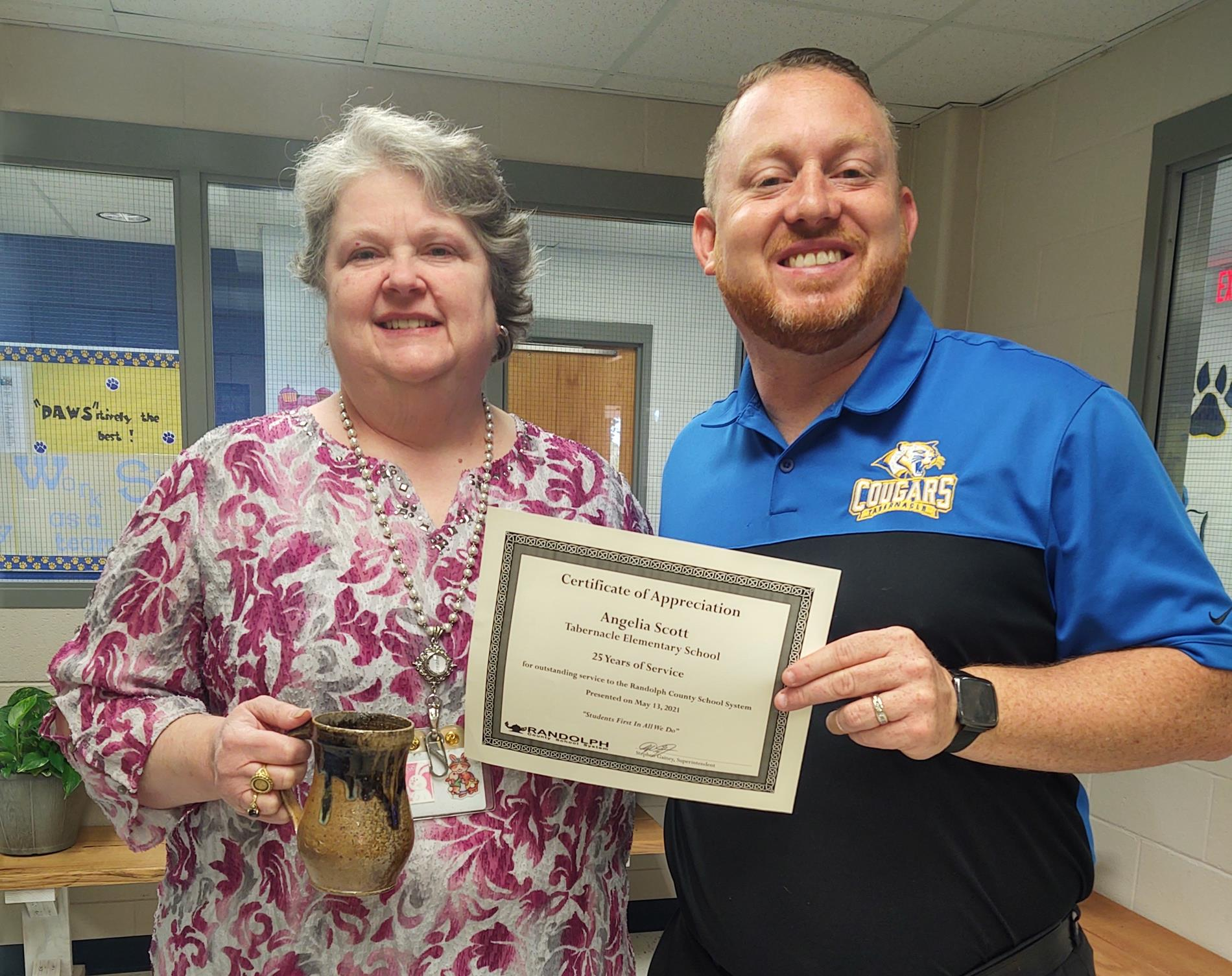 Mrs. Scott receives recognition for 25 years with the school system.