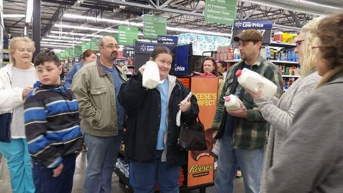 Discussion of different types of milk at grocery store.