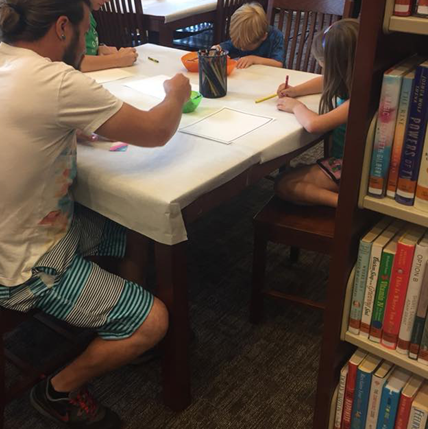 Family participating in a coloring program