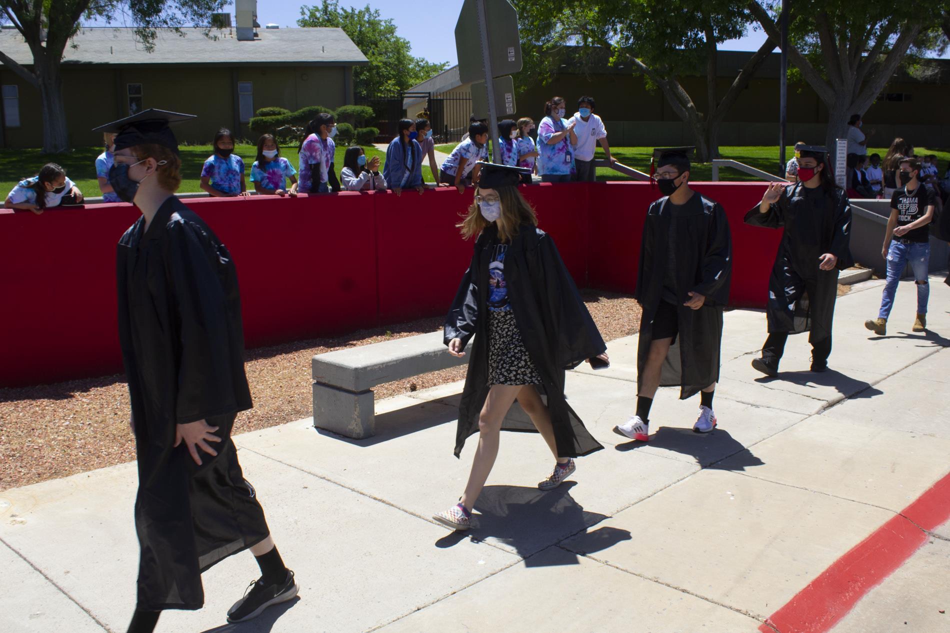 2021 grads doing grad walk in front of Desert View students
