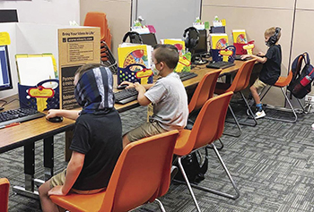 picture of students in the computer lab during on-site support