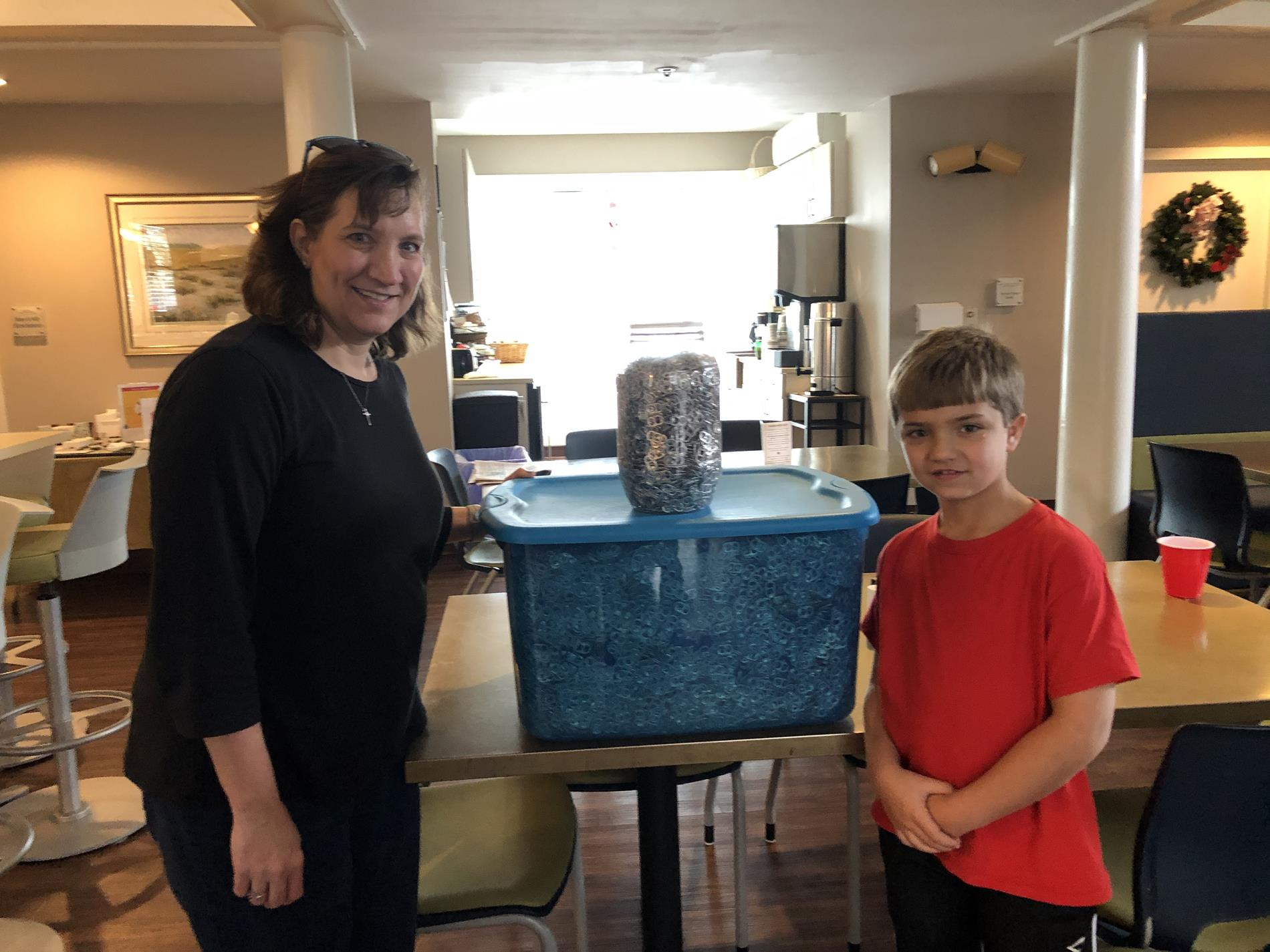 Picture of can tabs being delivered to the Ronald McDonald House.