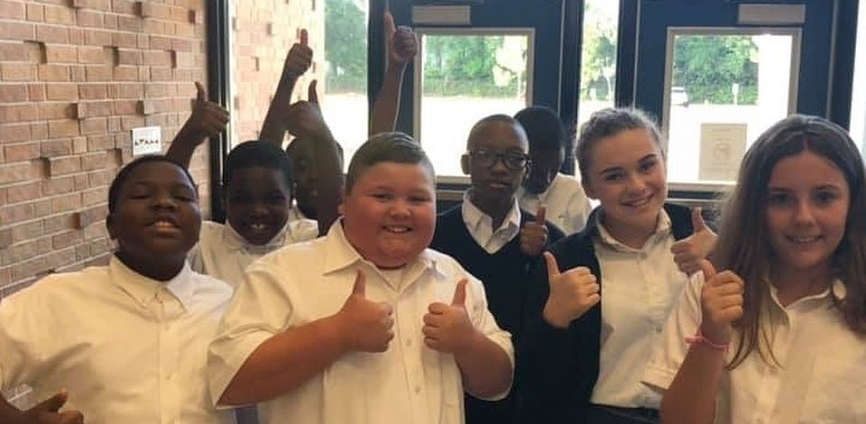 Students giving a thumbs up