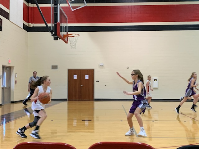 Lauren Ridge takes the ball down the court to her teammates