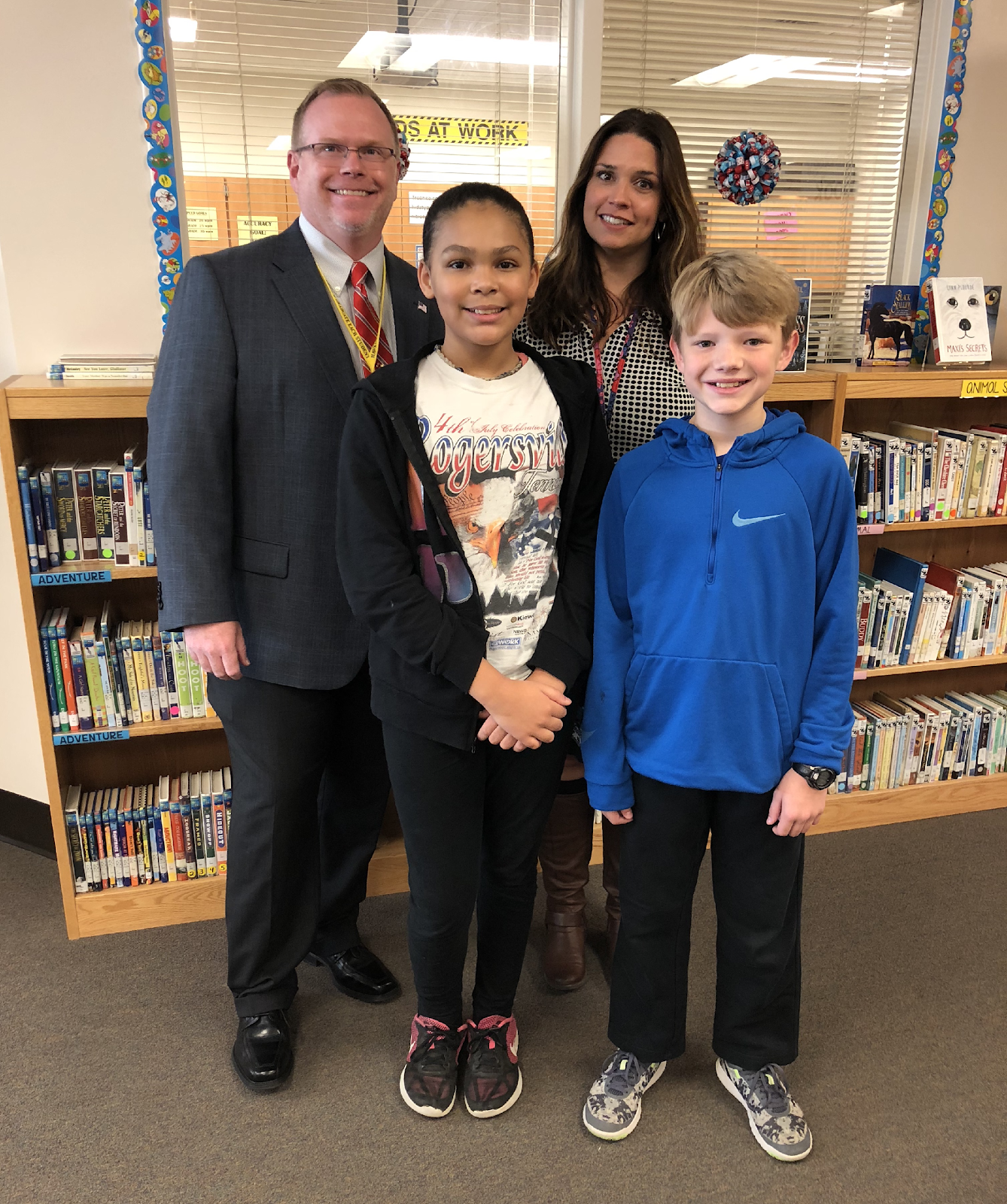 Aniyah Bandy, Clay Houck, teacher sponsor Ms. Stephanie Rebuck, and Attendance Supervisor Greg Sturgill.