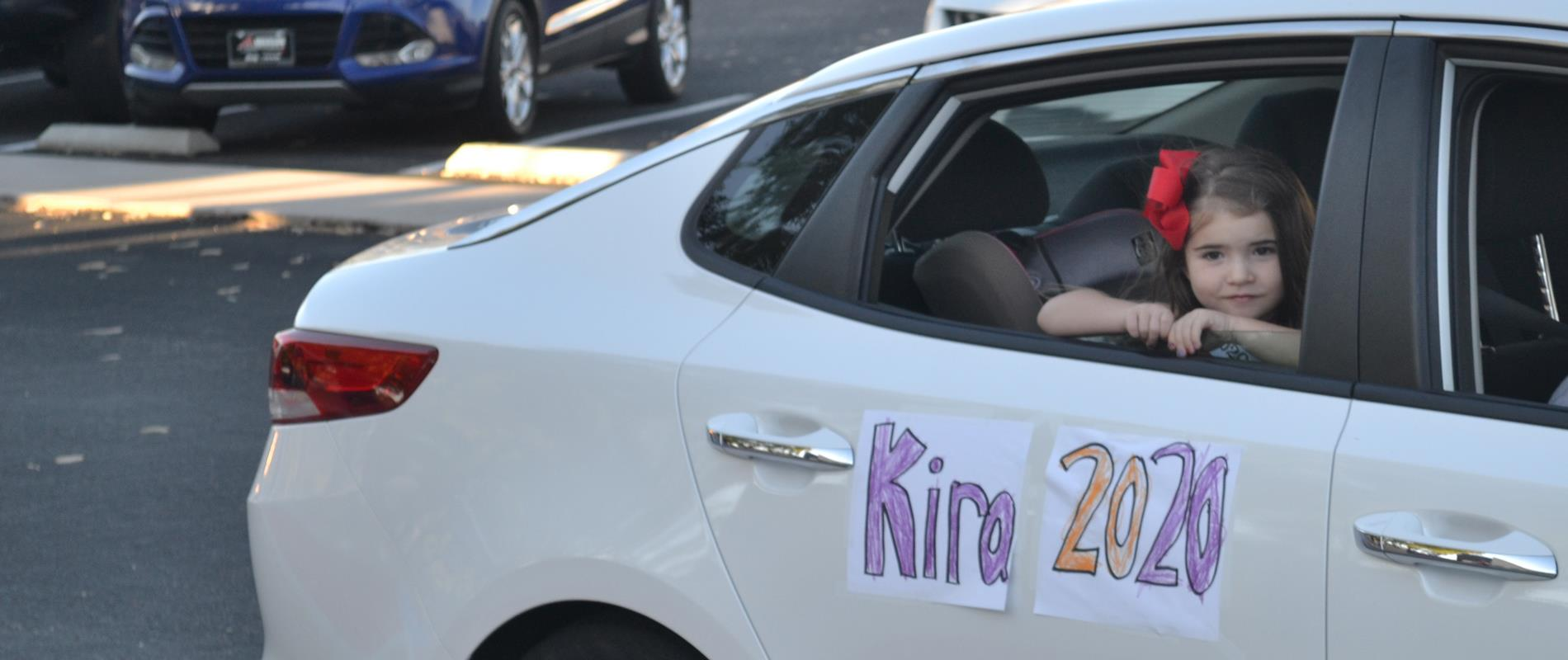 picture of kindergarten student at drive-thru graduation