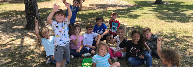 Steinhatchee kids holding up produce