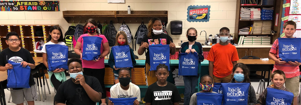Students with back to school bags