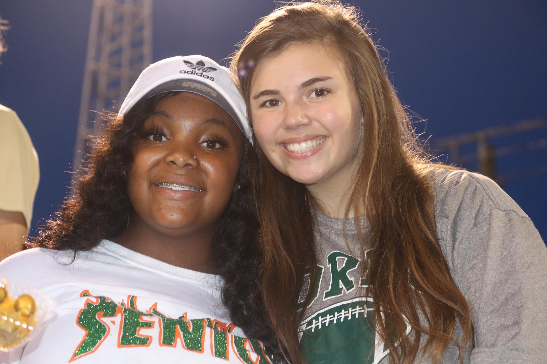 Tamia and Anna cheering on the Greenwave