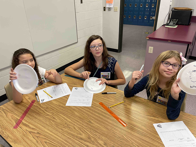 girls work on project at STEM Academy
