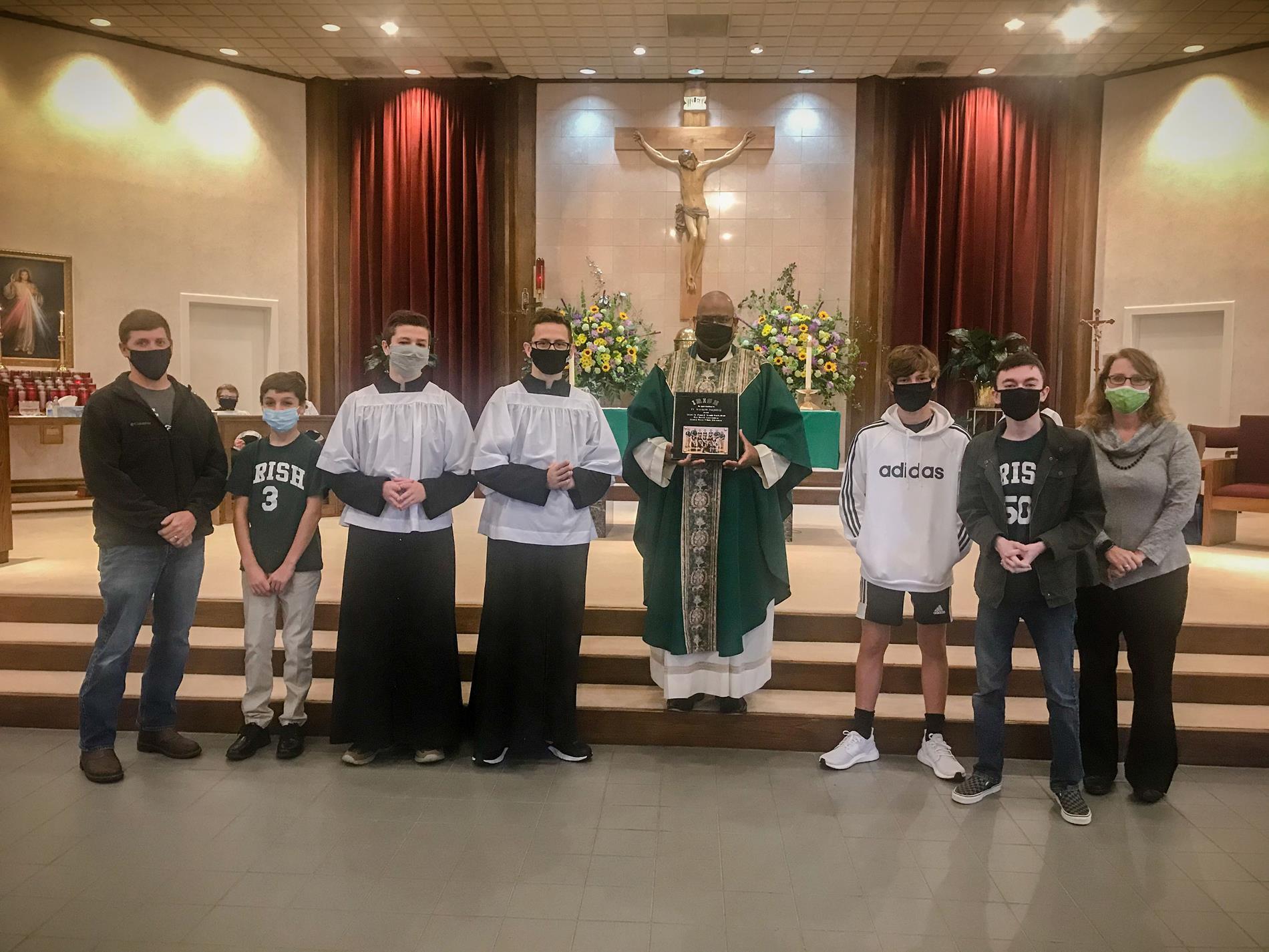 Basketball team/coaches and Father Vernon