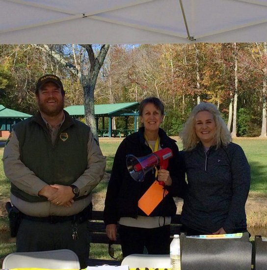 Brad Halfacre, Rochelle Turner, and Elise Driver working the registration table.