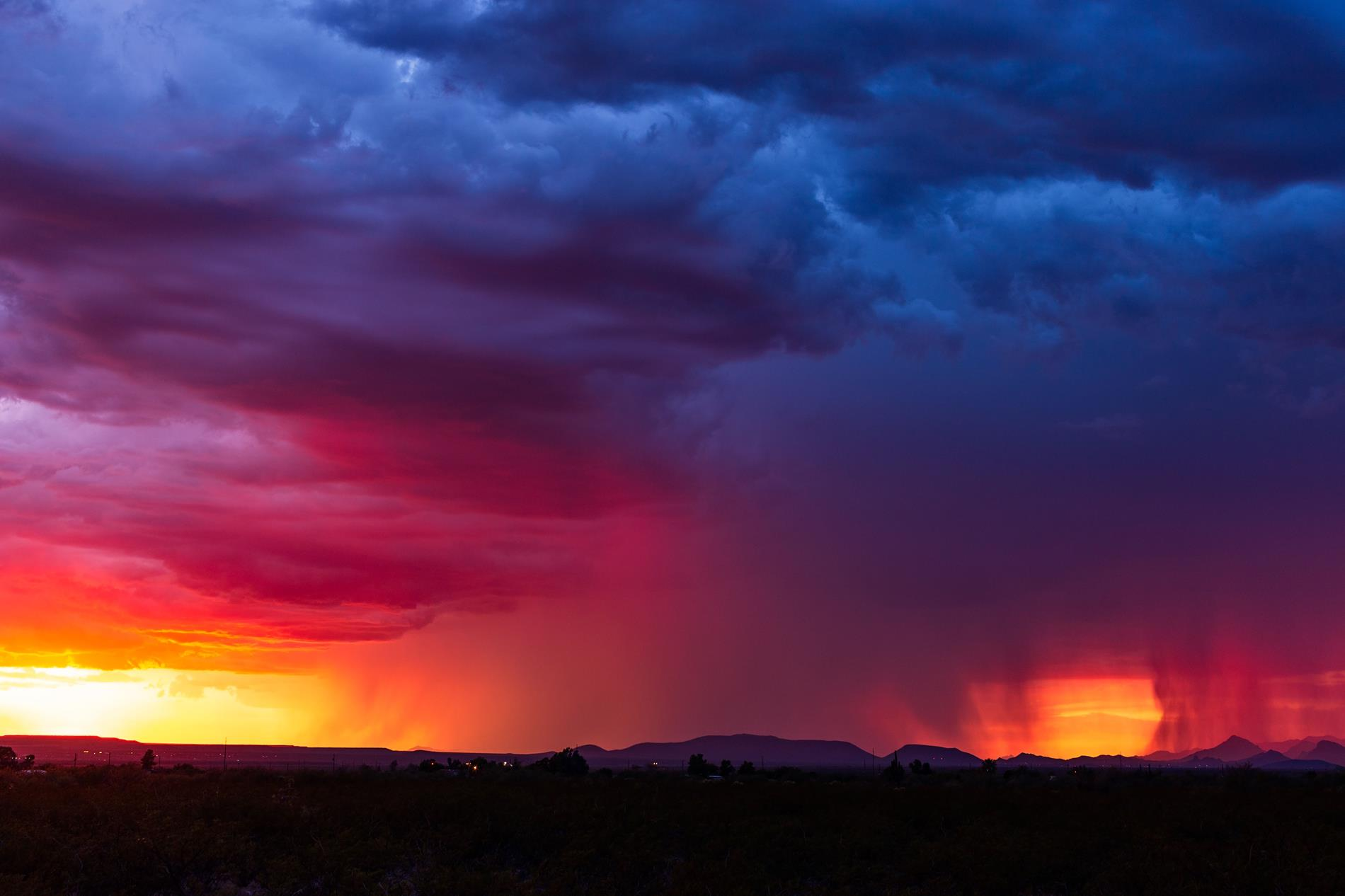desert rainstorym at sunset
