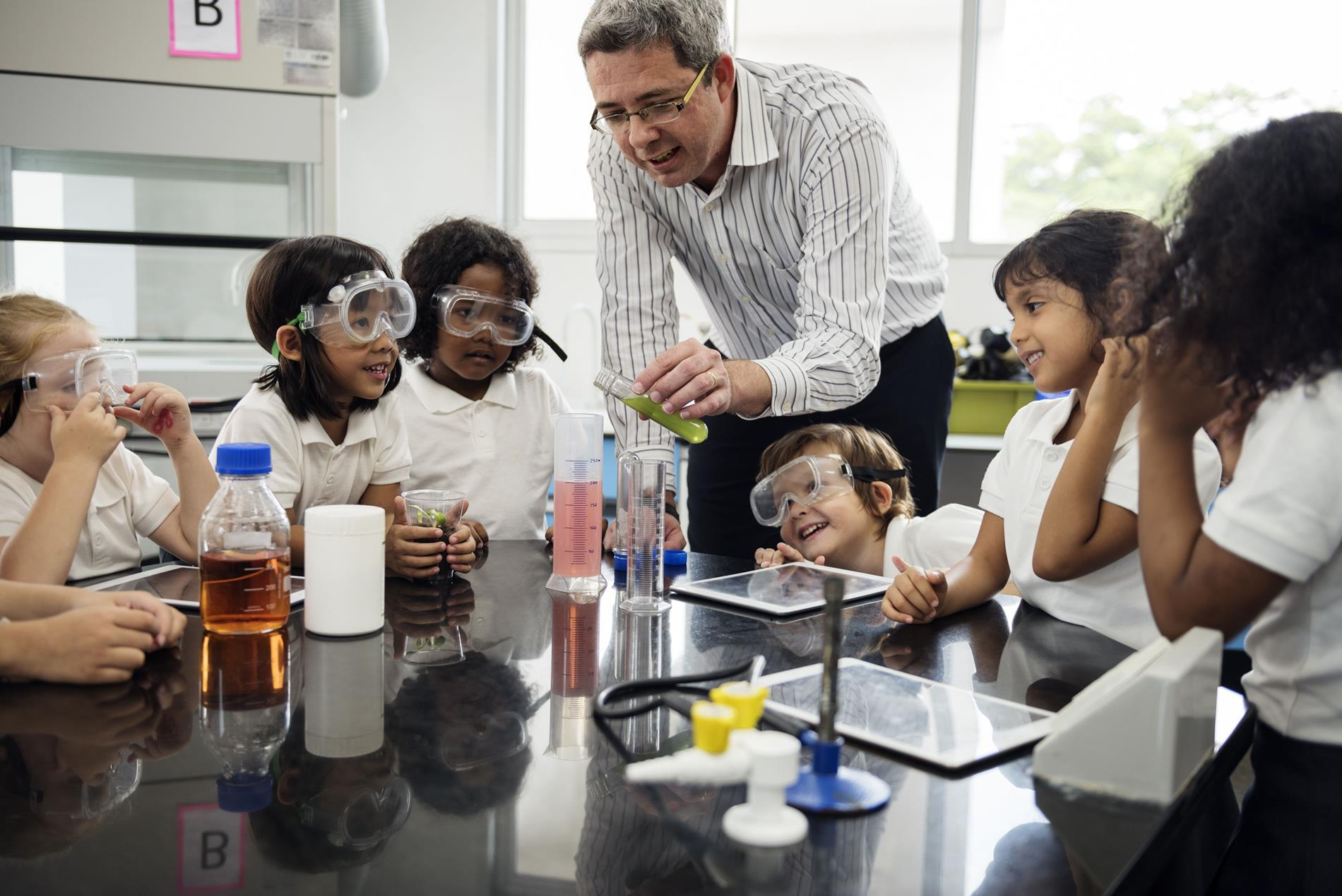Science Teacher with students