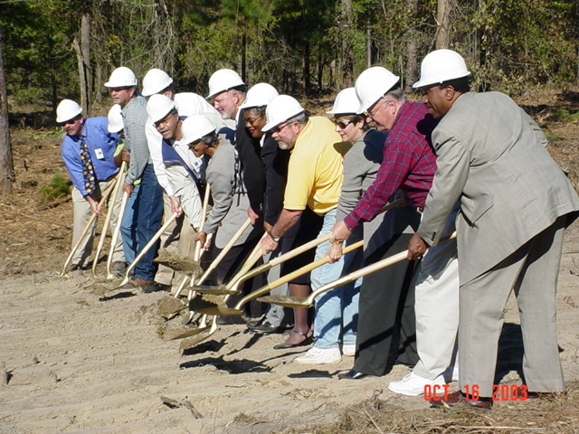 Members of the HCBOE join in the official groundbreaking.
