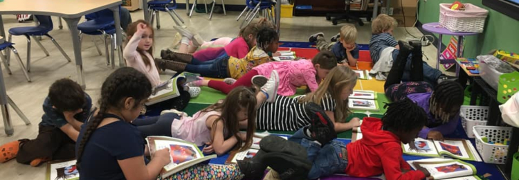 Students reading at Taylor County Primary School