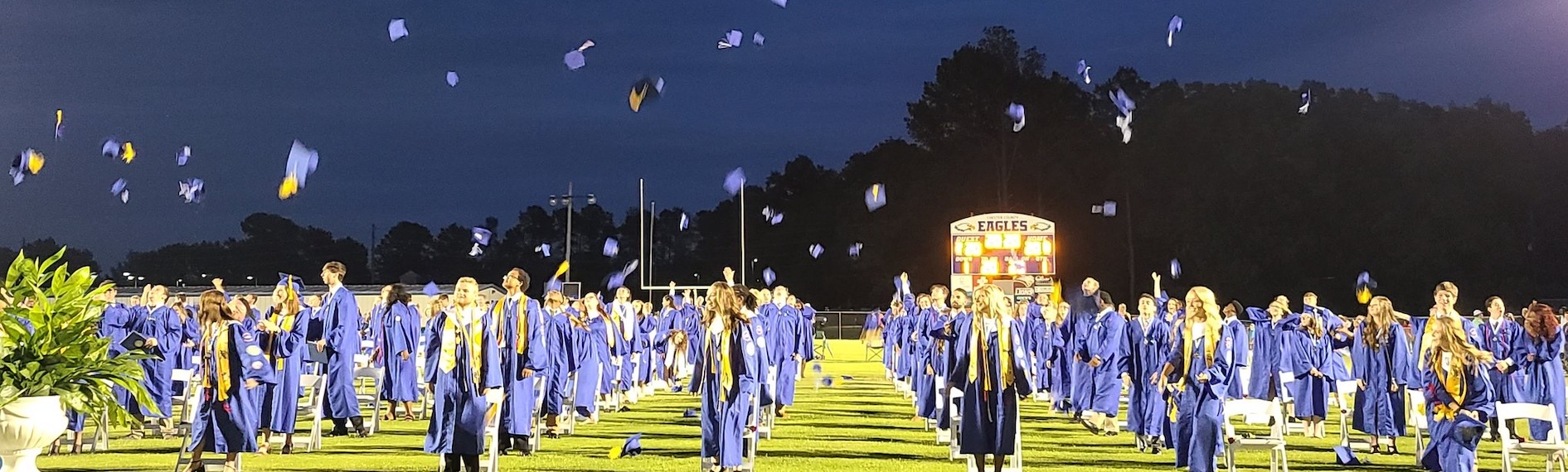Graduation Hats Flying