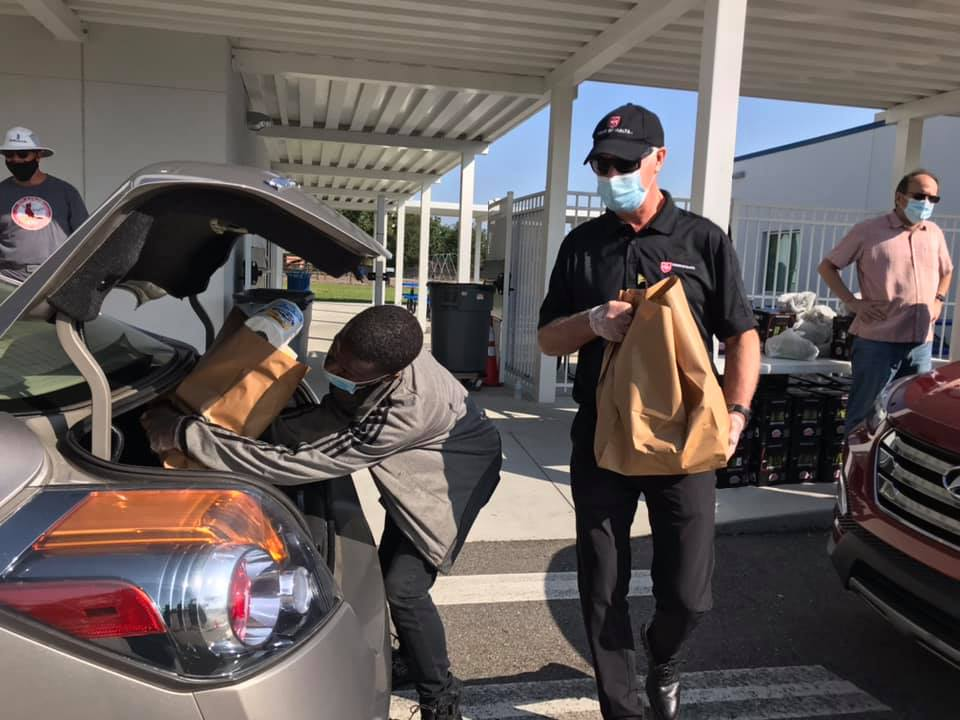 Loading More Food in the Back of a Car