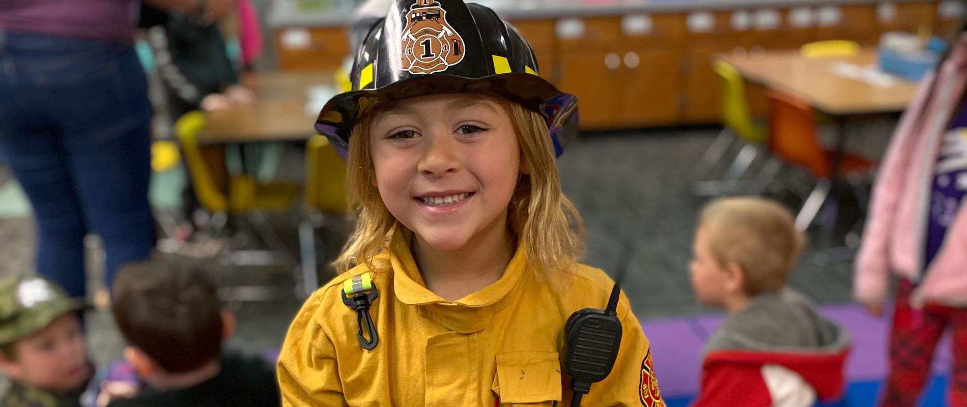picture of girl in a firefighter costume