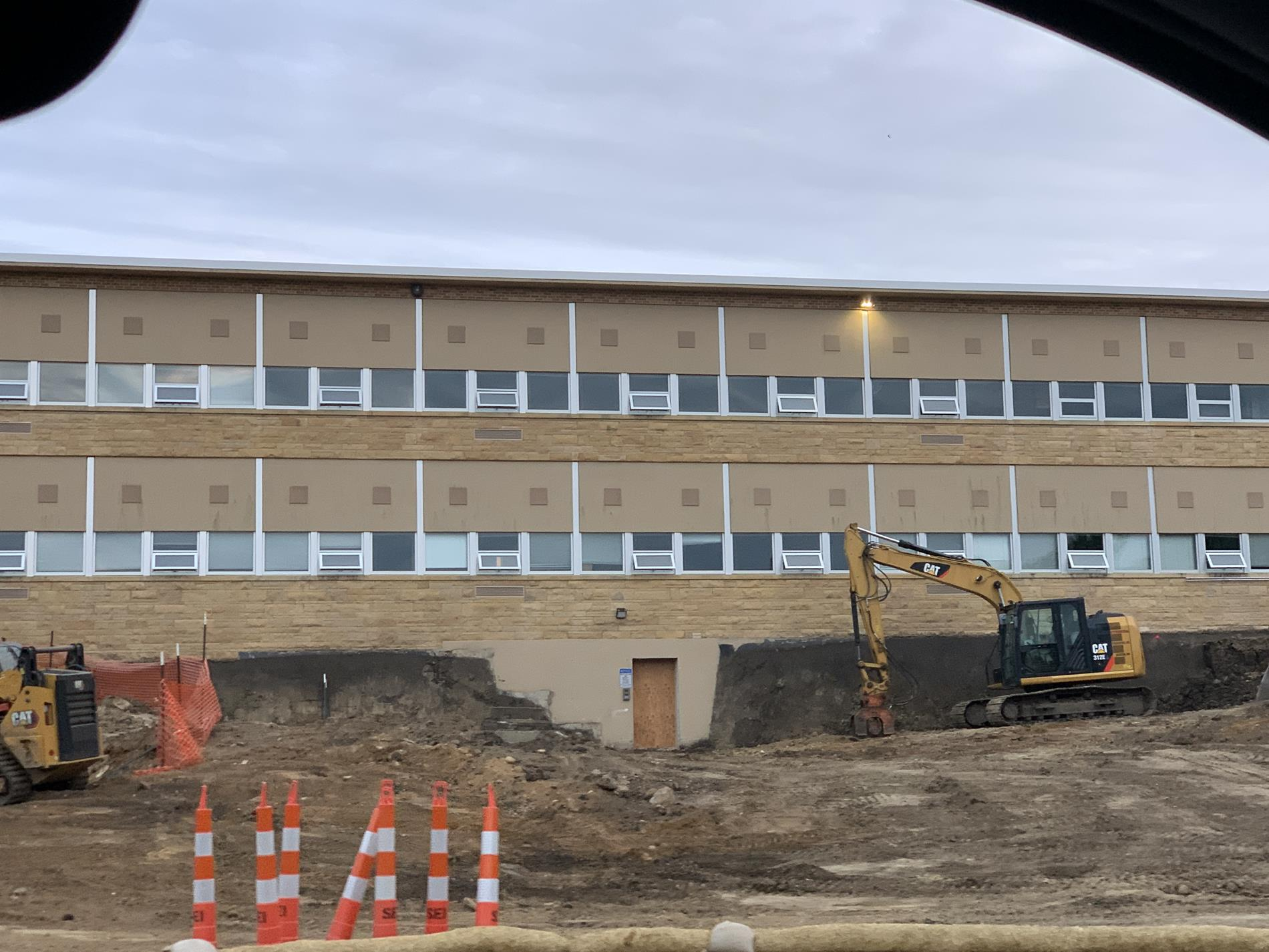 The retaining wall is down and they are doing dirt work for the project