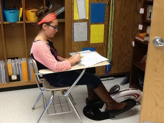 A DWS student using a DeskCycle.
