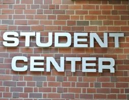 Brick wall with the text student center on it