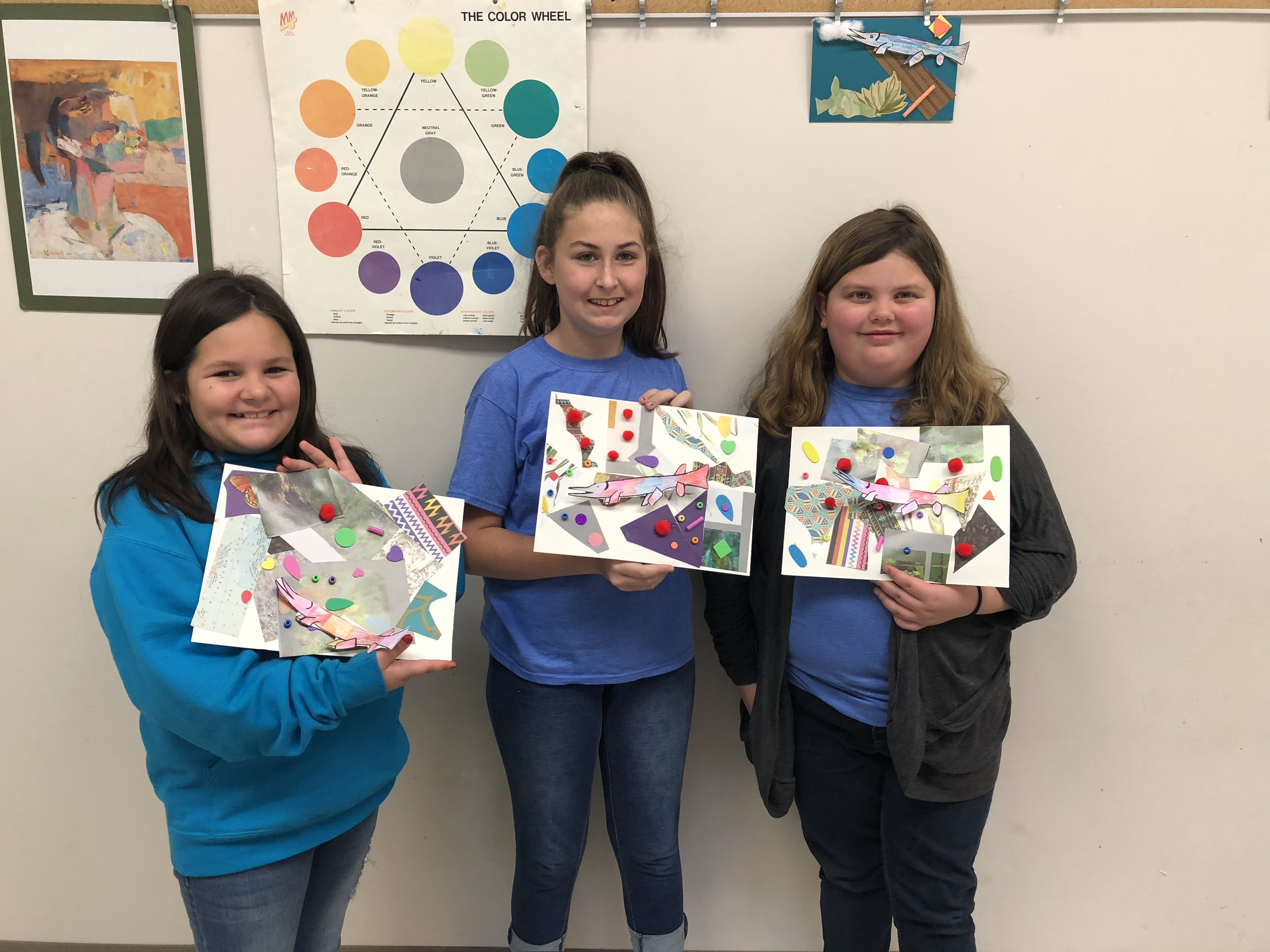 Students holding paintings