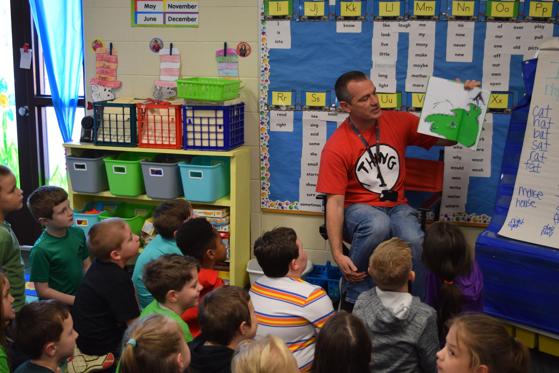 Jerry Cook, Assistant Principal, reading to kids