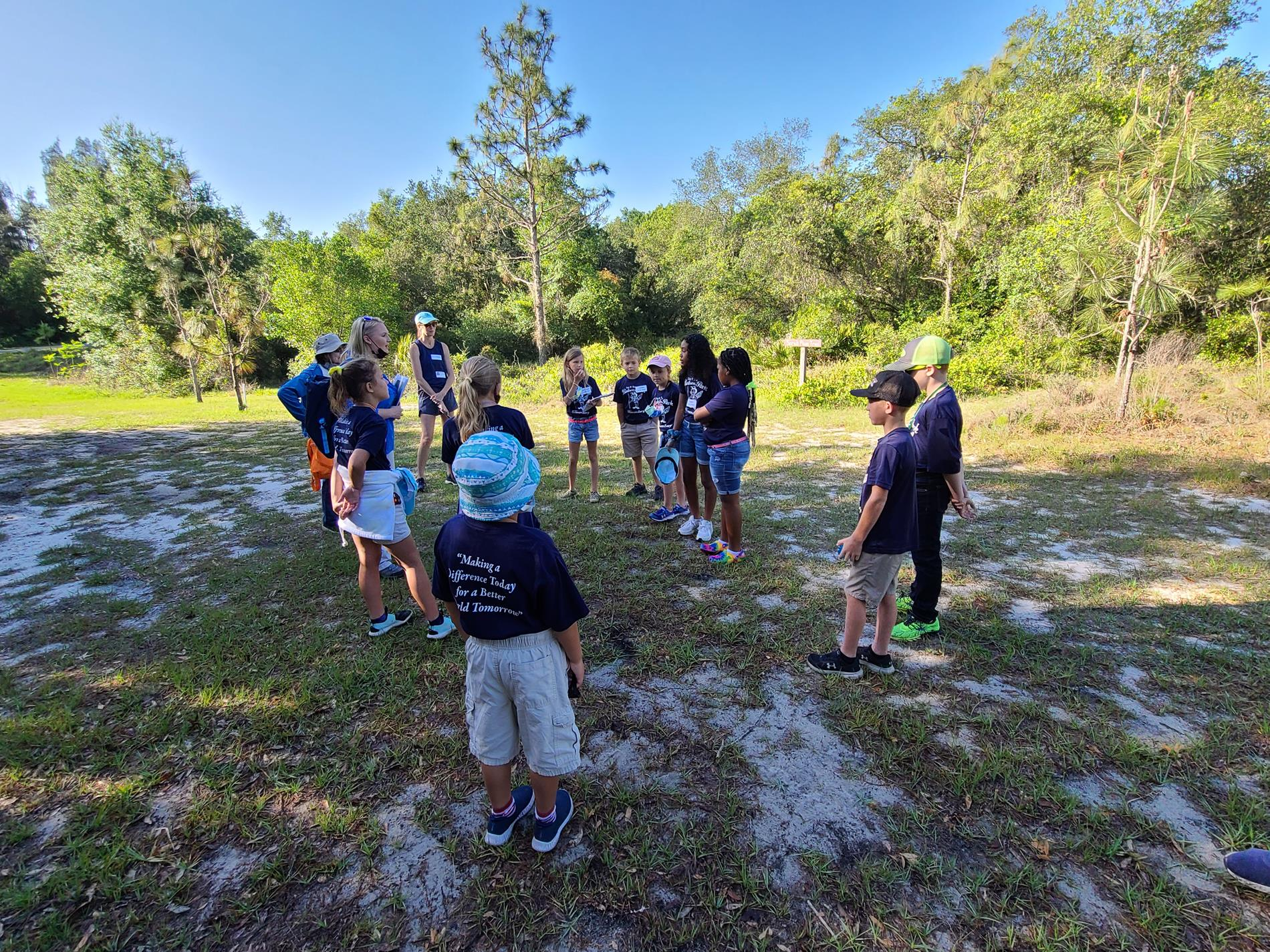 Students learning from their trail guides.