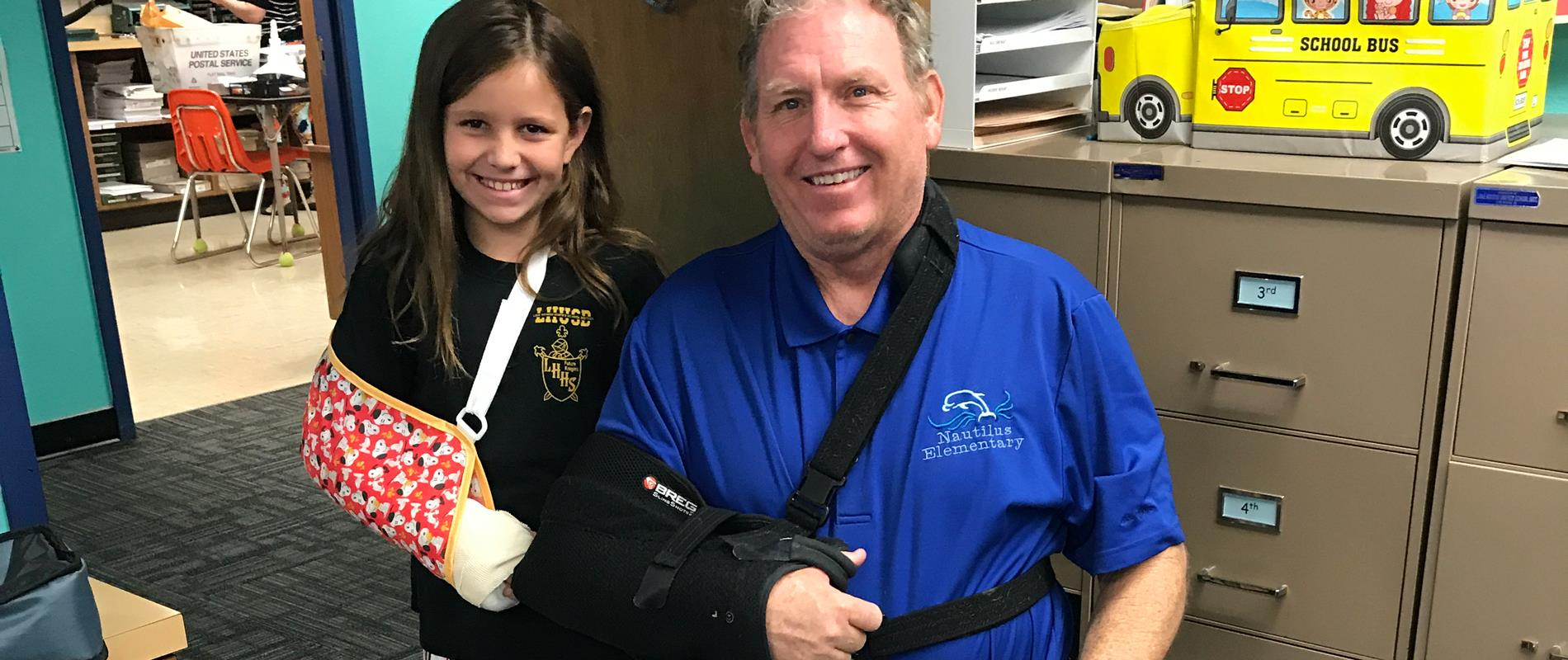 picture of girl and Principal with matching broken arms