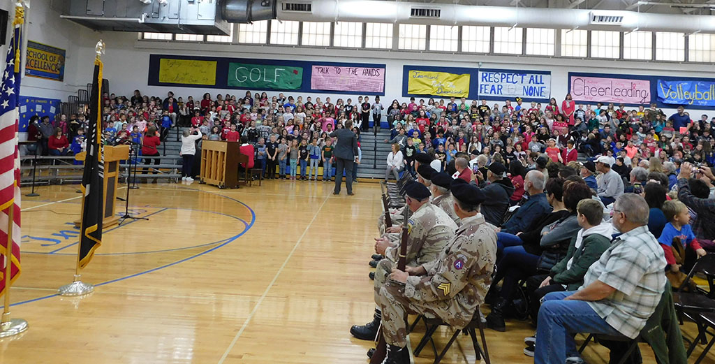 Elementary music class sings to veterans