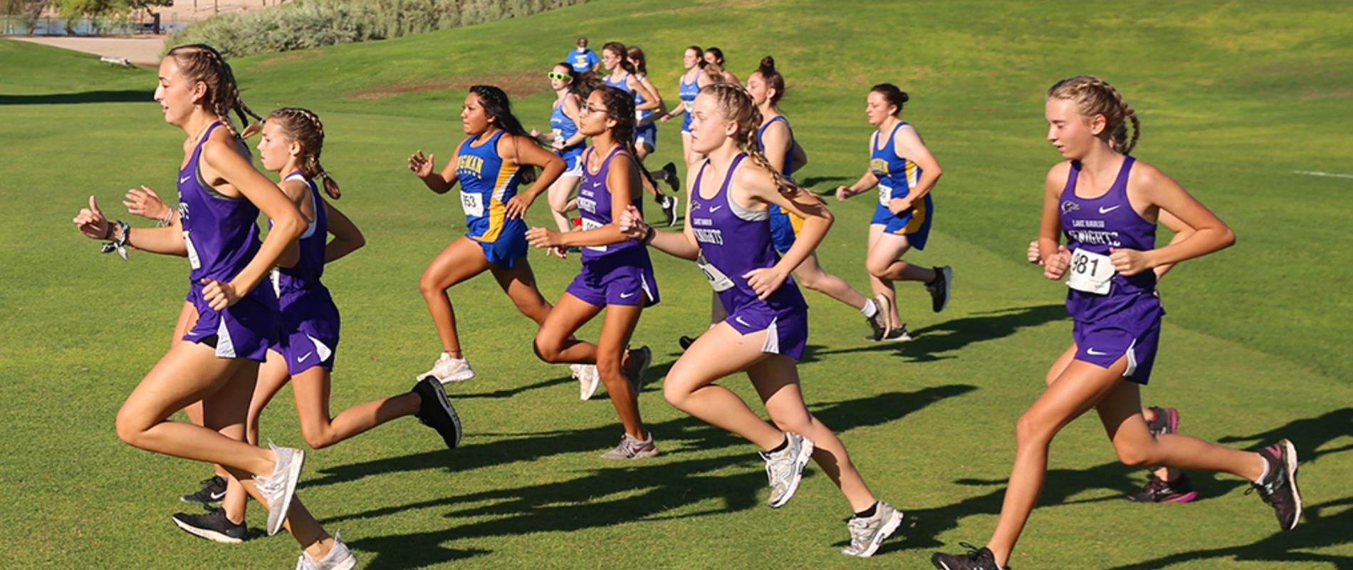 picture of girls track team competing in annual invitational